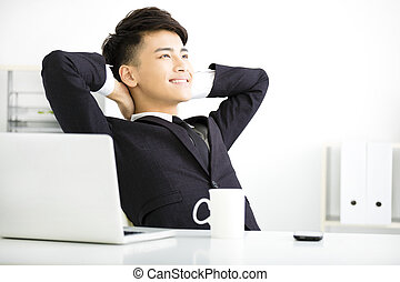 happy young  businessman relaxing in office