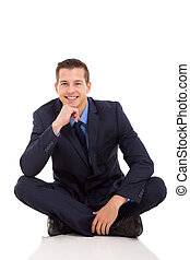 young businessman sitting on floor