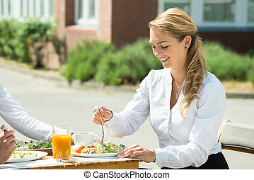 Businesswoman Eating Food