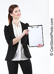 Happy young businesswoman holding blank paper on clipboard on wh