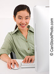 Happy young businesswoman using computer