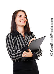 Happy young businesswoman writing on clipboard
