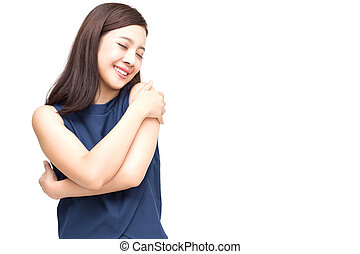 Happy young casual asian woman hugging herself isolated on white background. Love yourself concept