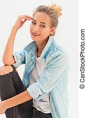 happy young casual woman sitting and thinking