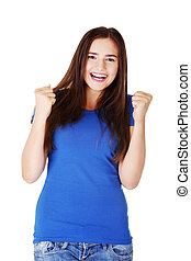 Happy young casual woman with closed fists.