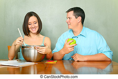 Happy Young Caucasian Couple Preparing Baking Or Cooking