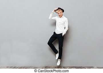 Happy young caucasian man standing isolated