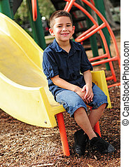 Happy young child and slide
