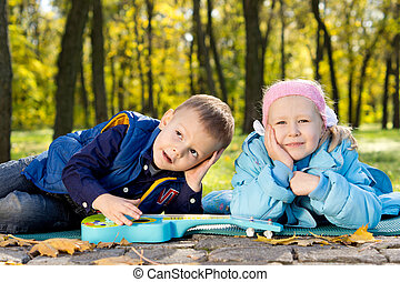 Happy Young Children Relaxing in a Park