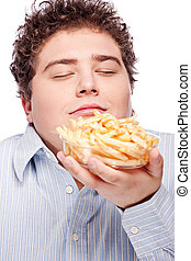 Happy young chubby man with French fries in dish, isolated on white