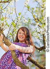 Happy Young Climbing Tree
