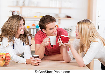 Happy young college students having coffee - Three happy...