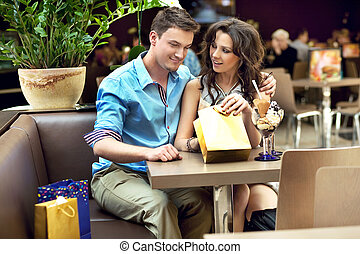happy young couple, a man gives a present to his wife