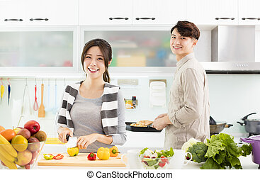happy young Couple cooking in the kitchen