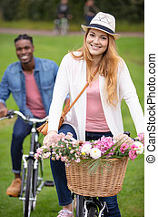 happy young couple cycling oudtoors