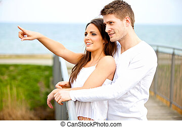 Happy Young Couple Dating Outdoors - Portrait of a happy...