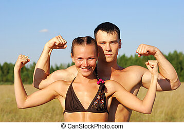 Happy young couple doing morning sports exercises