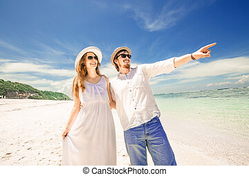 Happy young couple enjoying beach time on summer vacation