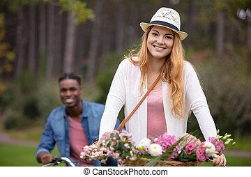 happy young couple enjoying bicycle ride