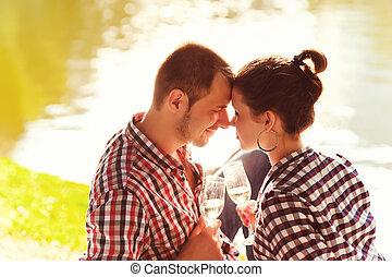 happy young couple enjoying picnic. Toned image