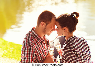 happy young couple enjoying picnic. Toned image