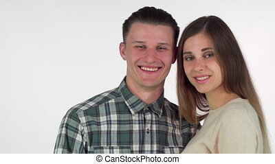 Happy young couple forming heart with their hands, smiling...