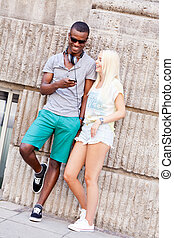 happy young couple have fun in the city summertime