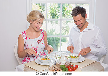 Happy young couple having food
