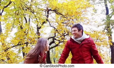 happy young couple having fun in autumn park