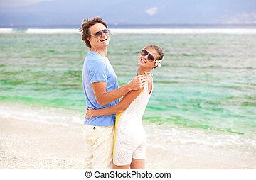 happy young couple having fun on the beach. honeymoon