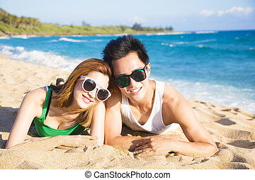 Happy young Couple having fun on the Beach