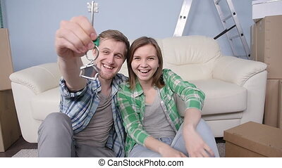 Young couple holding new flat keys - Happy Young couple...