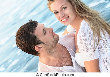 Happy young couple in a water