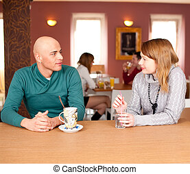 Happy young couple in cafe, having a great time together.