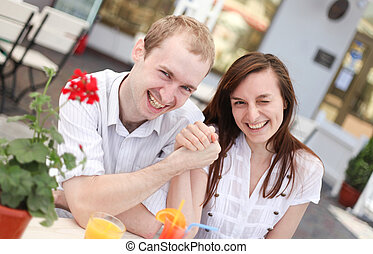happy young couple in cafe