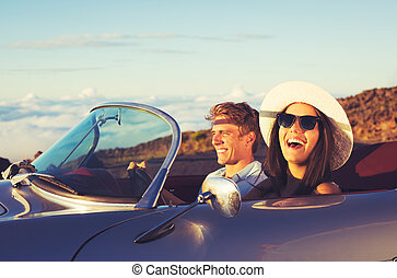 Young Couple in Classic Vintage Sports Car