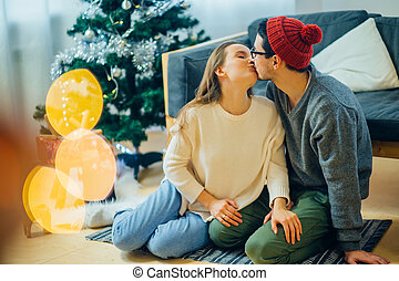 Happy Young Couple in having fun. love kiss