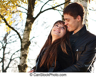 Happy young couple in love having fun autumn park on a...