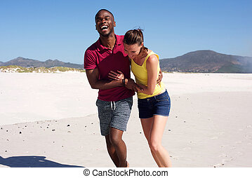 Happy young couple in love on beach