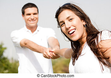 Happy young couple in playful mood focus on woman