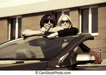 Happy young couple in the convertible car