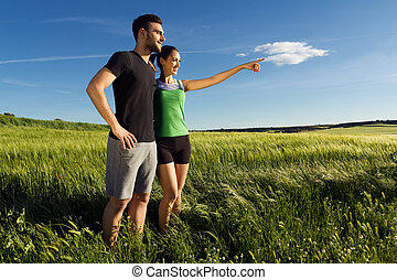 Happy young  couple  in the countryside