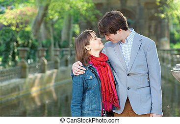 Happy young couple in the Luxembourg garden of Paris