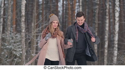Happy Young Couple in Winter Park having fun. Family Outdoors. love