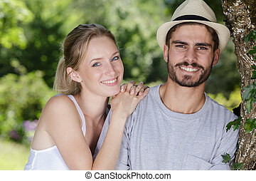 happy young couple looking at the camera