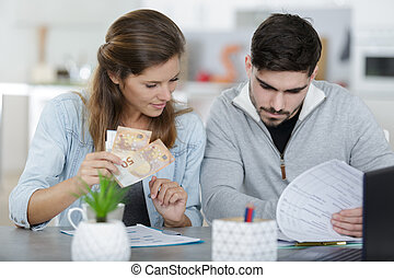 happy young couple managing finances