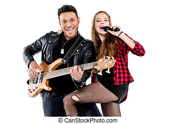 Happy young couple of musicians with microphone and electric guitar performing music together isolated on white