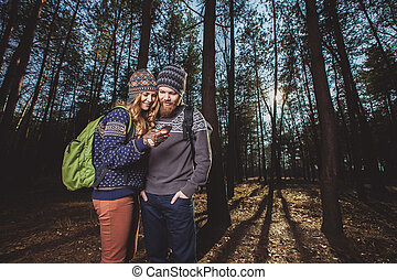 Happy young couple of tourists and taking selfie