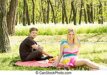 Happy young couple on a picnic date