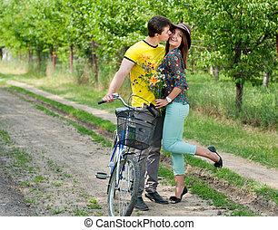 Happy young couple on bicycle